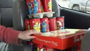 A Cape Breton, N.S. woman is trying to pay it forward, donating her winning 'roll up' prizes to strangers.