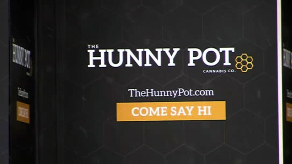 The logo for The Hunny Pot Cannabis Co. retail store is seen on Queen Street West.