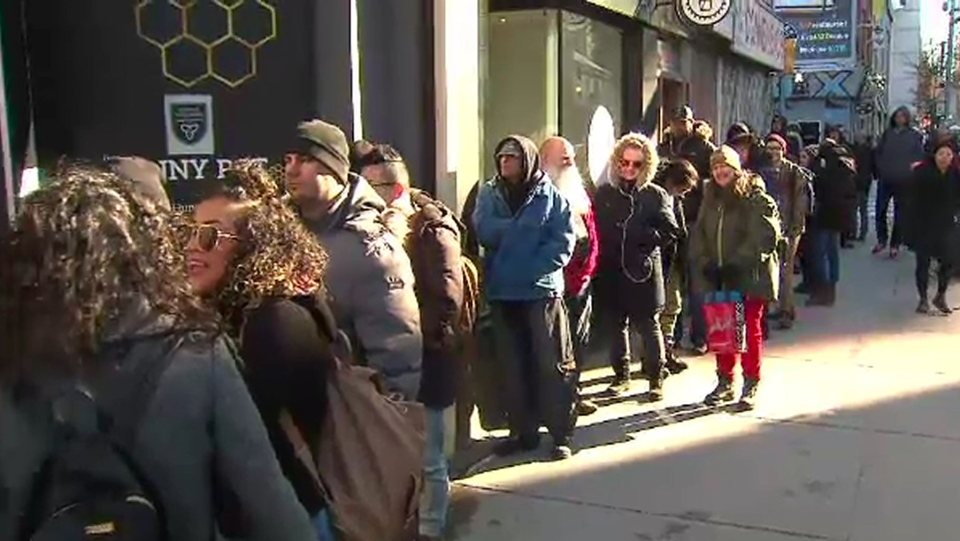 A line of customers outside The Hunny Pot on Queen Street West, Toronto's only cannabis store to open on April 1, 2019, as a slew of others await the completion of the approval process. (CTV)