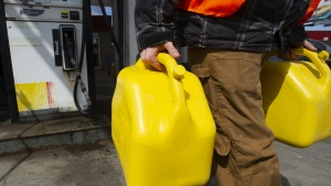 A worker fills up a jerrycan with diesel gas in Toronto, on Monday, April 1, 2019. THE CANADIAN PRESS / Christopher Katsarov