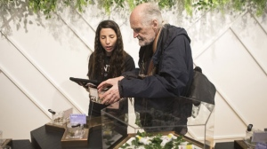 "Jean-Pierre Fortin (right) shops for cannabis on the first morning of opening at Toronto's ""The Hunny Pot,"" one of the retail stores licensed to sell Cannabis in Ontario, on Monday, April 1, 2019. THE CANADIAN PRESS/Chris Young"