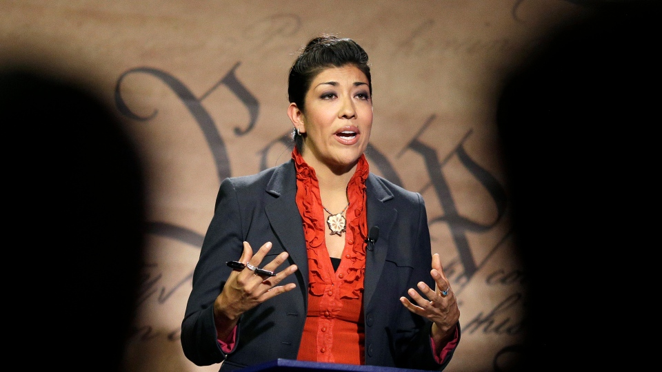 FILE - In this Oct. 15, 2014 file photo, Nevada state Democratic Assemblywoman Lucy Flores speaks during a debate with Nevada state Republican Sen. Mark Hutchison in Las Vegas. (AP Photo/John Locher, File)