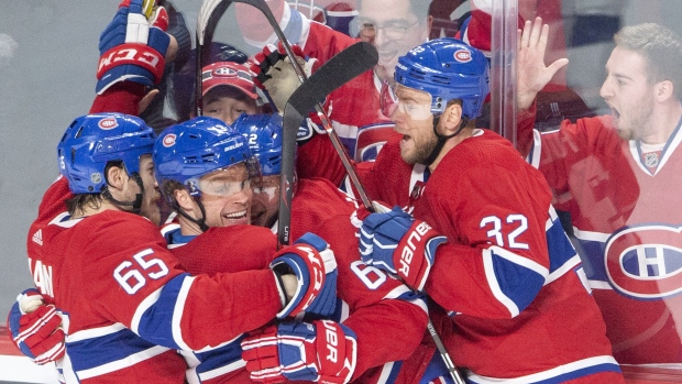 Montreal Canadiens centre Max Domi, second left, celebrates with teammates after scoring the team's fourth goal against the Tampa Bay Lightning. THE CANADIAN PRESS/Ryan Remiorz