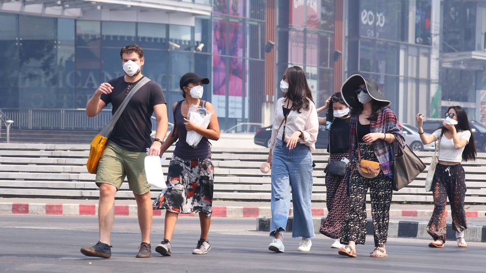 Tourists wear masks in Chiang Mai province, Thailand, Tuesday, April 2, 2019. (AP Photo/Maytanan Merchant)
