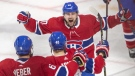 Montreal Canadiens right wing Joel Armia (40) celebrates with teammates Shea Weber (6) and Tomas Tatar (90) after scoring his team's second goal against the Tampa Bay Lightning during second period NHL hockey action Tuesday, April 2, 2019 in Montreal. THE CANADIAN PRESS/Ryan Remiorz