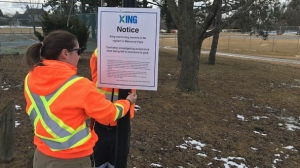 Warning signs were placed in a King City, Ont. park where suspected poison was found. (Photo: John Musselman/CTV Toronto)