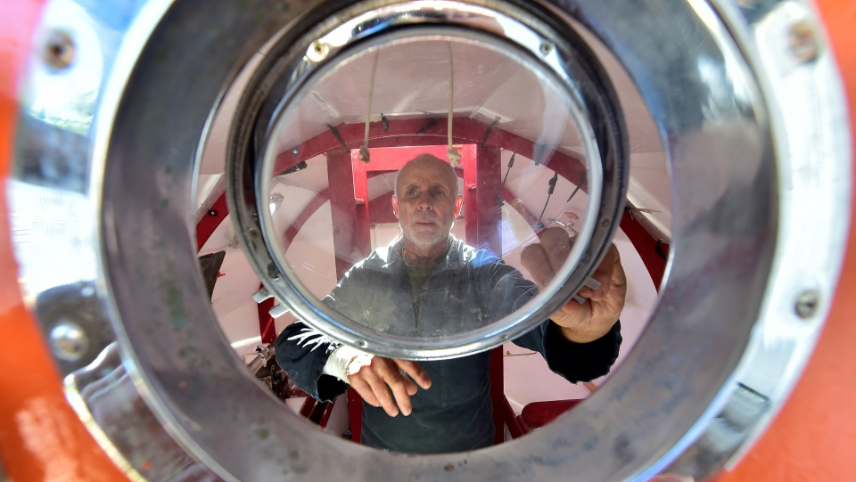Jean-Jacques Savin, a former paratrooper, 71, working on the construction of a ship made from a barrel (Georges Gobet / AFP)