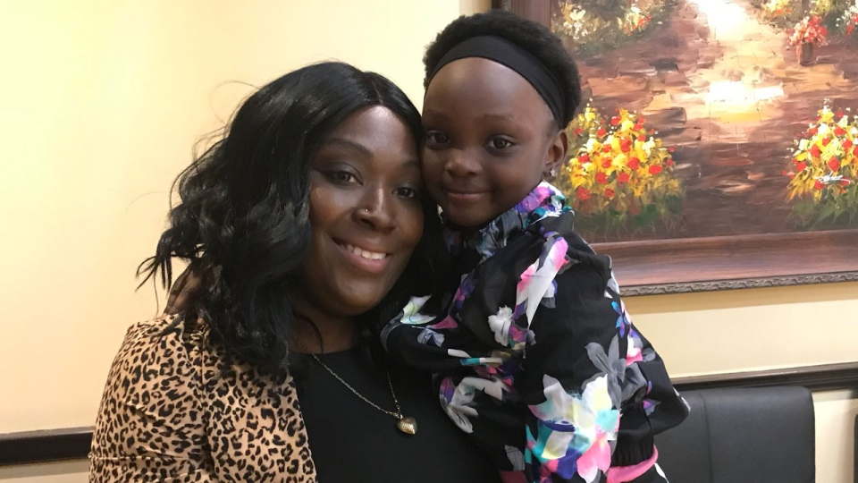 Le'Anna Felix and her five-year-old daughter are seen.