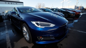 In this Sunday, Feb. 3, 2019, file photograph, an unsold 2019 S75D sits at a Tesla dealership in Littleton, Colo. (AP Photo/David Zalubowski, File)