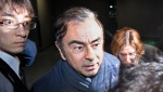 In this April 3, 2019, file photo, former Nissan Chairman Carlos Ghosn, center, leaves his lawyer's office in Tokyo. Japanese prosecutors took Nissan's former Chairman Ghosn for questioning Thursday, April 4, barely a month after he was released on bail ahead of his trial on financial misconduct charges. (Sadayuki Goto/Kyodo News via AP, File)