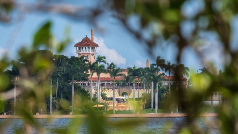 This Nov. 23, 2018 file photo shows U.S. President Donald Trump's Mar-a-Lago estate behind mangrove trees in Palm Beach, Fla. (AP Photo/J. David Ake)