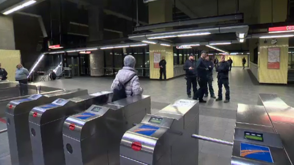 STM inspectors stand ready to check tickets for people entering the Metro system in Montreal.