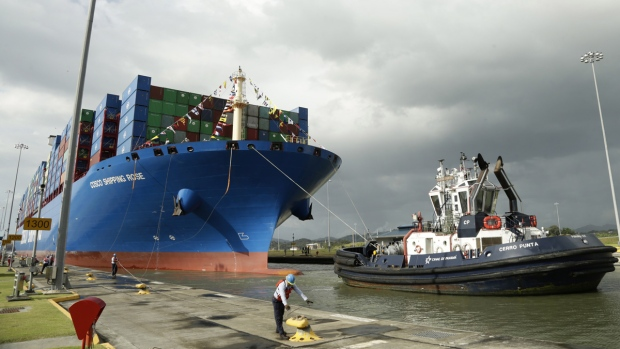 A Panama Canal worker docks a Chinese ship