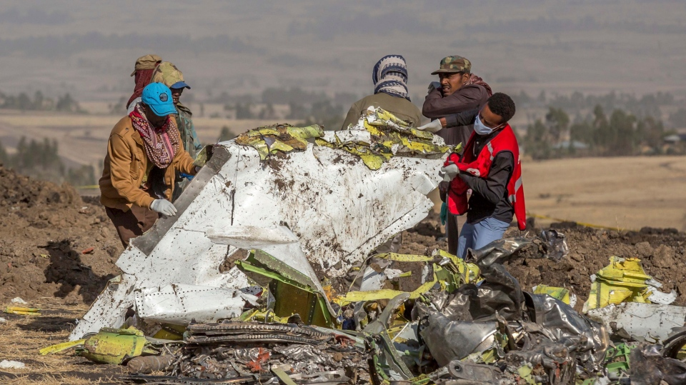 In this March 11, 2019, file photo, rescuers work at the scene of an Ethiopian Airlines flight crash near Bishoftu, Ethiopia. A published report says pilots of an Ethiopian airliner that crashed followed Boeing's emergency steps for dealing with a sudden nose-down turn but couldn't regain control. (AP Photo/Mulugeta Ayene, File)