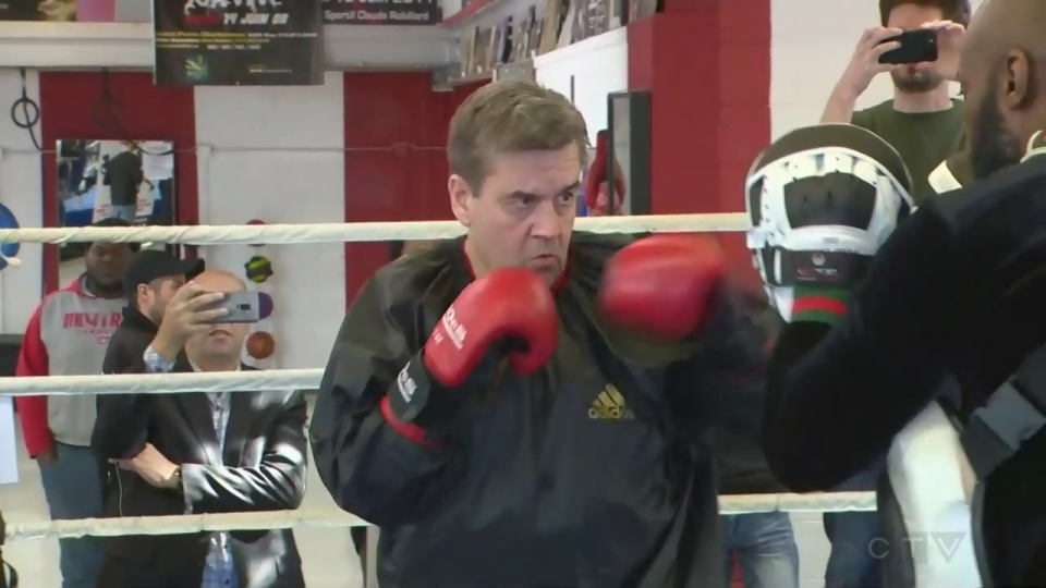 Denis Coderre faces his trainer, Ali Nestor, in the boxing ring.