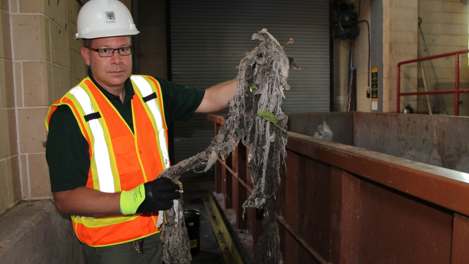 Ryerson University researcher Barry Orr holds up a build-up of non-flushable wipes retrieved from a wastewater collection plant. (Photo courtesy of Ryerson University)