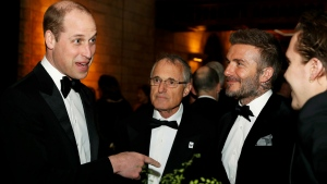 """Prince William, left, talks with David Beckham, second right, during the global premiere of Netflix's """"Our Planet"""" at the Natural History Museum in London, Thursday April 4, 2019. (John Sibley/Pool via AP)"""