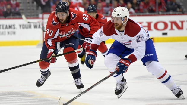 Washington Capitals Tom Wilson (43) and Montreal Canadiens Jeff Petry (26) chase down the puck during the second period of their NHL hockey game in Washington, Thursday, April 4, 2019. (AP Photo/Susan Walsh)