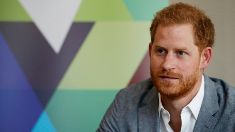 Prince Harry listens to the Youth Ambassadors Mental Health Champions during a visit to YMCA South Ealing in London, Wednesday, April 3, 2019.  (Adrian Dennis/Pool Photo via AP)