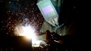 A welder fabricates a steel structure at an iron works facility in Ottawa on Monday, March 5, 2018. THE CANADIAN PRESS/Sean Kilpatrick
