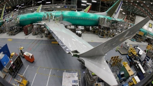 In this March 27, 2019, file photo taken with a fish-eye lens, a Boeing 737 MAX 8 airplane sits on the assembly line during a brief media tour in Boeing's 737 assembly facility in Renton, Wash. (AP Photo/Ted S. Warren, File)