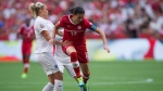 Christine Sinclair, right, leaps past a challenge from England's Steph Houghton during second half FIFA Women's World Cup quarter-final soccer action in Vancouver, B.C., on Saturday June 27, 2015. (Darryl Dyck / THE CANADIAN PRESS)