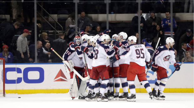 Columbus Blue Jackets swarm goaltender Sergei Bobrovsky, left, of Russia, after he made three saves during the shootout against the New York Rangers during an NHL hockey game Friday, April 5, 2019, in New York. The Montreal Canadiens have been eliminated from the NHL playoff race.THE CANADIAN PRESS/AP-Julio Cortez