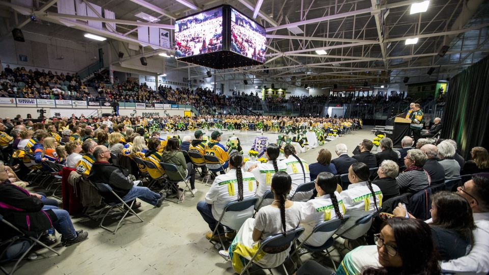 Community members and dignitaries join with family members during the Humboldt Broncos memorial service at Elgar Petersen Arena in Humboldt, Sask. on Saturday, April, 6, 2019. THE CANADIAN PRESS/POOL-Liam Richards