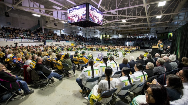 Community members and dignitaries join with family members during the Humboldt Broncos memorial service at Elgar Petersen Arena in Humboldt, Saskatchewan on Saturday, April, 6, 2019. THE CANADIAN PRESS/POOL-Liam Richards