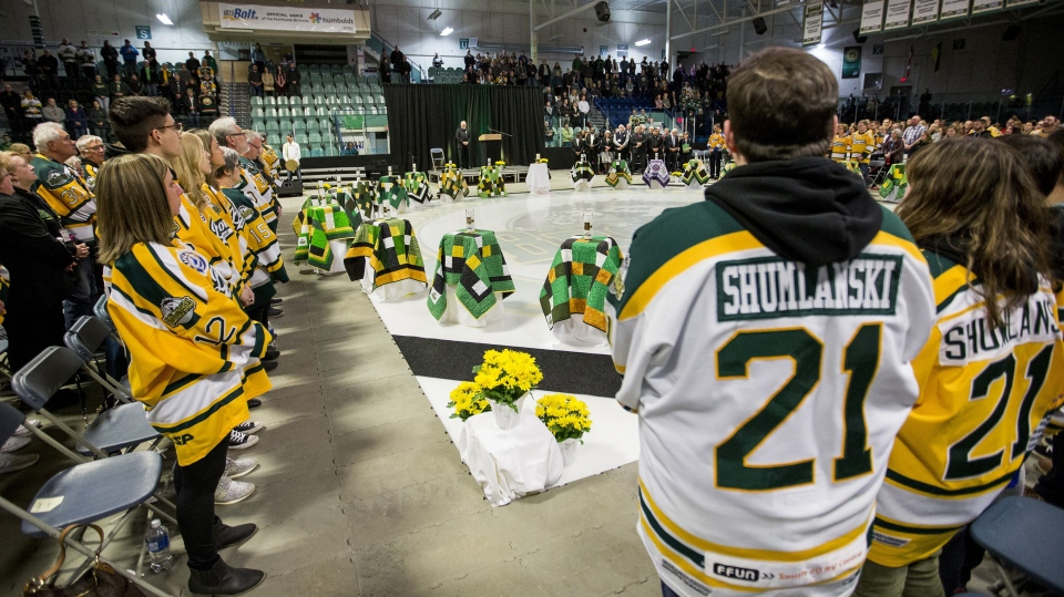 Family members and community members join in a moment of silence during the Humboldt Broncos memorial service at Elgar Petersen Arena in Humboldt, Sask. on Saturday, April, 6, 2019. THE CANADIAN PRESS/POOL-Liam Richards