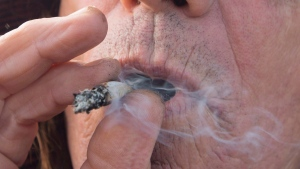 A man smokes a marijuana joint in Kamloops, B.C. Wednesday, Oct. 17, 2018. (THE CANADIAN PRESS / Jonathan Hayward)