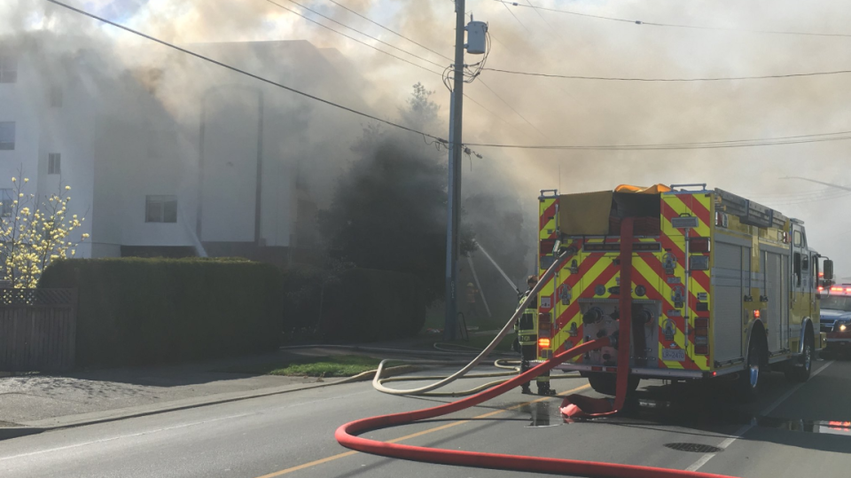 Heavy smoke pours from the top floor of an Esquimalt apartment building on Craigflower Road.