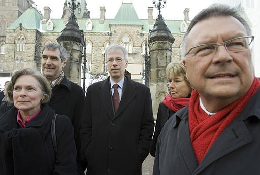 Liberal leader Stephane Dion (centre) arrives for a news conference with caucus whip Karen Redman (left), Deputy leader Michael Ignatieff (2nd from left), Leader of the Opposition in the Senate Celine Hervieux-Payette, and House leader Ralph Goodale (right) to announce his shadow cabinet, in Ottawa Thursday Jan. 18, 2007. (CP /Tom Hanson)