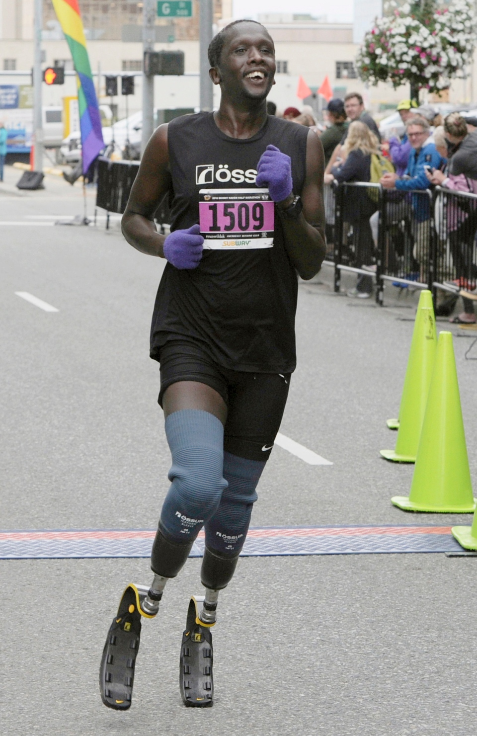FILE - In this Aug. 19, 2018, photo, Marko Cheseto, a college All-American who lost both feet to frostbite after being stranded outside in an Alaskan blizzard in 2011, competes in the Skinny Raven Half Marathon during the Anchorage RunFest in Anchorage, Alaska. (Bill Roth/Anchorage Daily News via AP, File)