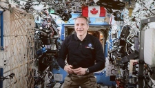 Canadian Space Agency astronaut David Saint-Jacques is seen on a live monitor from the International Space Station during a video conference with Prime Minister Justin Trudeau and Governor General Julie Payette and a group of students at Rideau Hall in Ottawa on Monday, Jan. 14, 2019. THE CANADIAN PRESS/Sean Kilpatrick