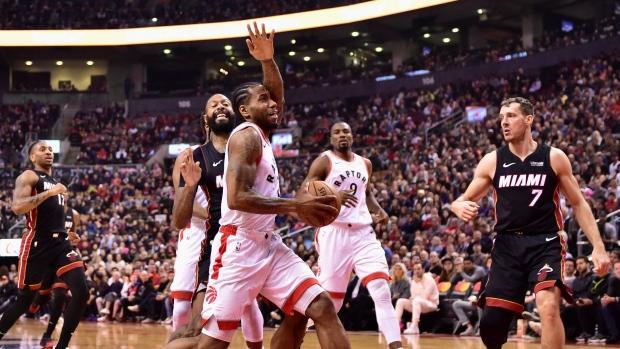 d06bc4b17 Miami Heat forward James Johnson (16) fouls Toronto Raptors forward Kawhi  Leonard (2) as he drives to the net during first half NBA basketball action  in ...