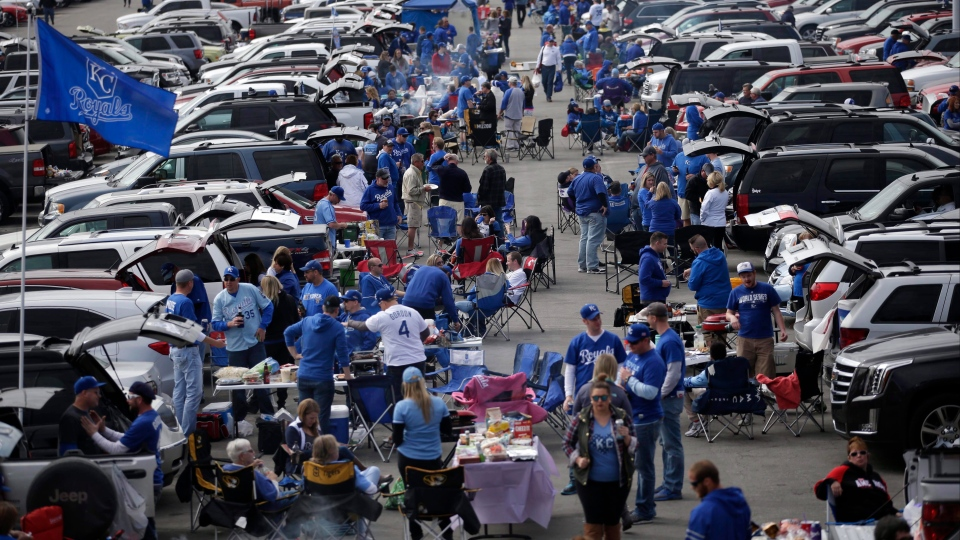 Fans tailgate before Game 2 of baseball's American League Championship Series between the Kansas City Royals and the Toronto Blue Jays on Saturday, Oct. 17, 2015, in Kansas City, Mo. (AP Photo/Jae C. Hong)