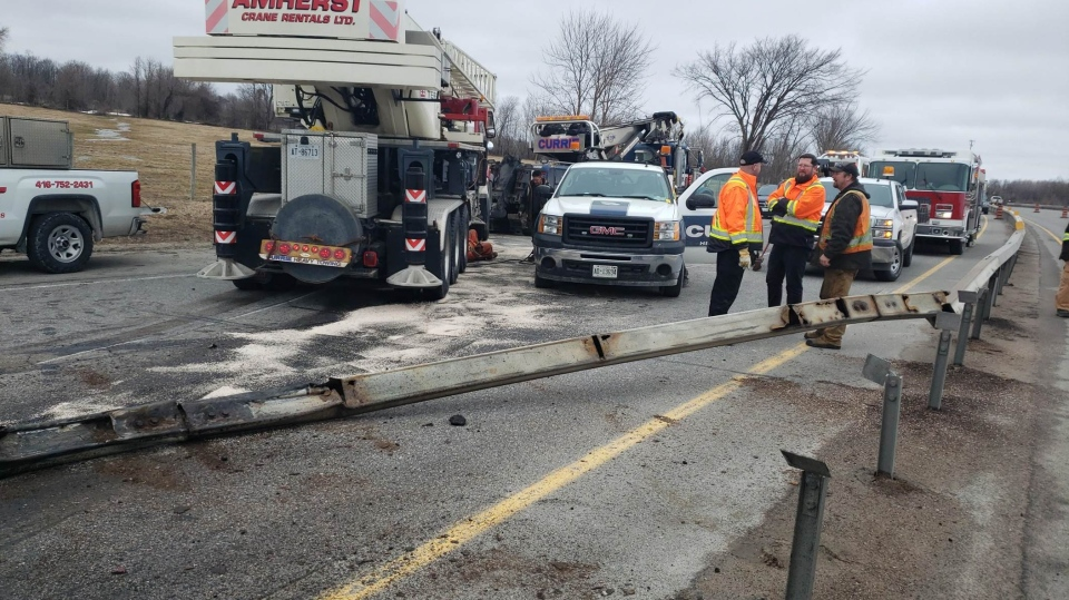 Industrial crane plows through centre median and shuts down