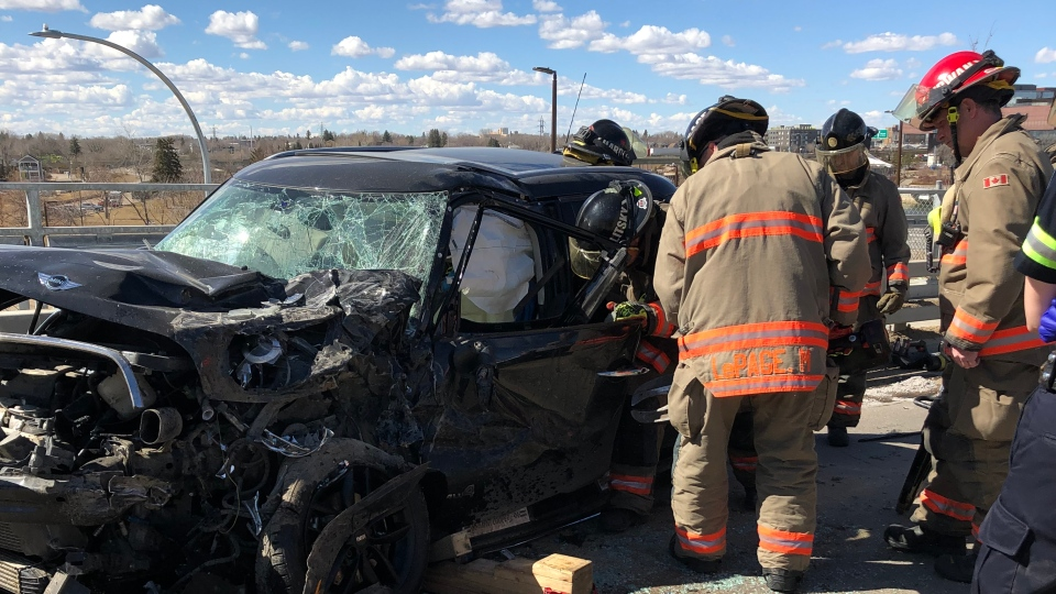 Firefighters extricated the driver of a Mini Cooper car after a head-on crash with a Ford Escape on the Traffic Bridge early Monday afternoon. (Courtesy Saskatoon Fire Department)