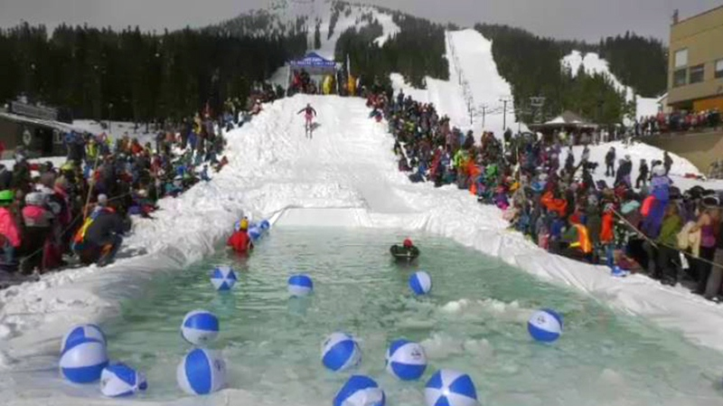 Dozens of costume-clad skiers and snowboarders made their way down a specially constructed slope and into a pond of cold, slushy water for Mount Washington's 'Slush Cup.' April 7, 2019. (CTV Vancouver Island)