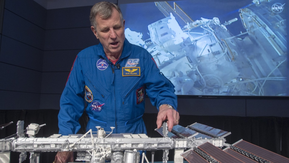 Retired Canadian astronaut Dave Williams gives a play-by-play of Canadian astronaut David Saint-Jacques' spacewalk, Monday, April 8, 2019 in Quebec.(THE CANADIAN PRESS/Ryan Remiorz)