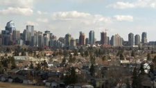 Calgary skyline appears behind Hillhurst