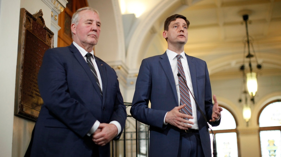 B.C. Attorney General David Eby and Federal Minister of Border Security and Organized Crime Reduction Bill Blair speak to media following a meeting to discuss money laundering on March 27, 2019. (THE CANADIAN PRESS/Chad Hipolito)