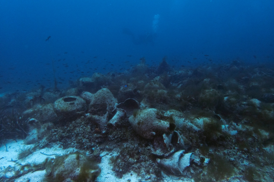 In this photo taken on Sunday, April 7, 2019, ancient amphoras lie at the bottom of the sea from a 5th Century B.C. shipwreck, the first ancient shipwreck to be opened to the public in Greece. (AP Photo/Elena Becatoros)