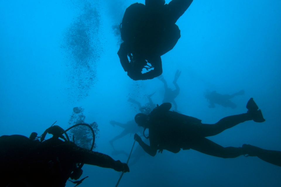 In this photo taken on Sunday, April 7, 2019, divers visit a 5th Century B.C. shipwreck, the first ancient shipwreck to be opened to the public in Greece. (AP Photo/Elena Becatoros)