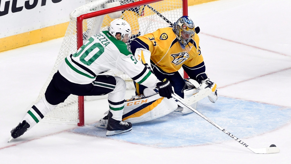 Dallas Stars center Jason Spezza (90) scores a goal against Nashville Predators goalie Pekka Rinne (35) during the third period of an NHL hockey game, Tuesday, Oct. 18, 2016, in Nashville, Tenn. Both players are hoping to capture their first Stanley Cup this year. (AP Photo/Mark Zaleski)