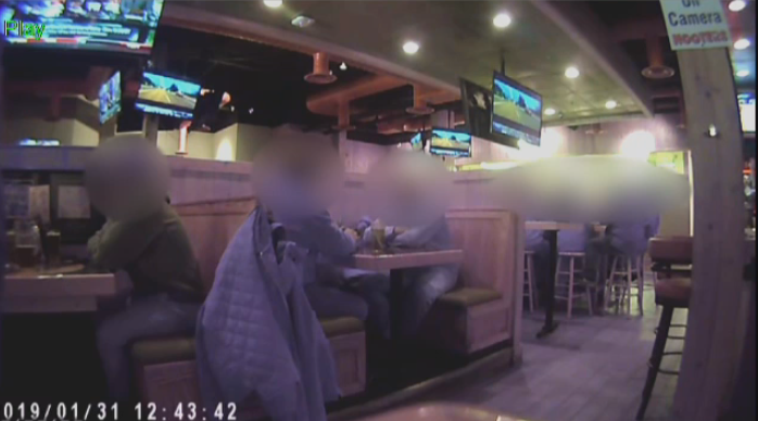File image taken from surveillance footage recorded by a private investigator that alleged city workers were caught on video doing personal activities during work hours.