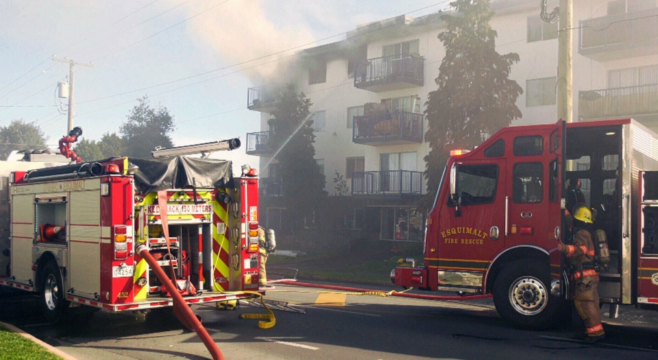 A woman in Esquimalt, B.C., died after a fire in her apartment building left her trapped on her balcony.