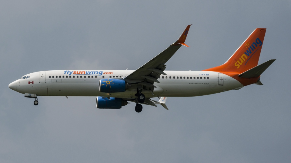 A Sunwing Boeing 737-800 passenger plane prepares to land at Pearson International Airport in Toronto on Wednesday, August 2, 2017. THE CANADIAN PRESS/Christopher Katsarov