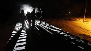 Early Sunday morning, February 26, 2017, eight migrants from Somalia cross into Canada illegally from the United States by walking down this train track into the town of Emerson, Man., where they will seek asylum at Canada Border Services Agency. THE CANADIAN PRESS/John Woods